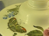 Butterfly on the base of an item